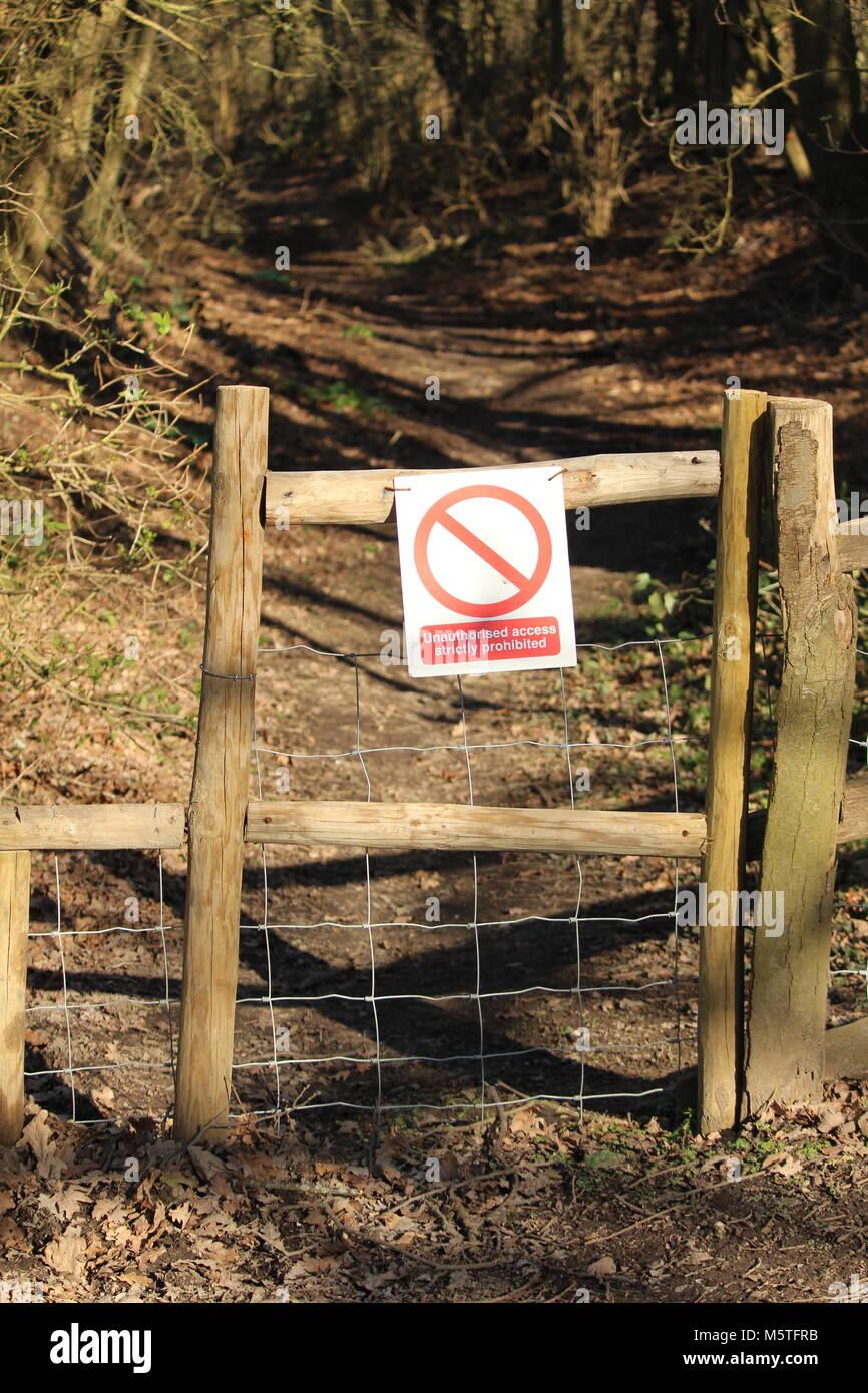 Private property signage on fence gate. Cobham Woods, Kent, UK - Stock Image