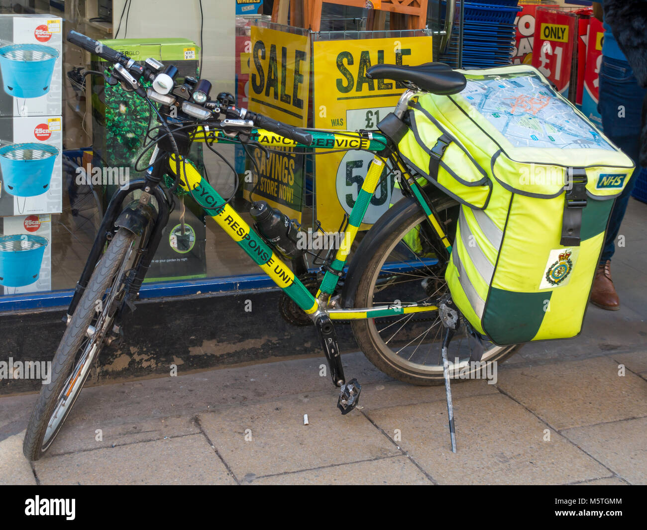 NHS National Health Service Emergency Response Ambulance service bicycle for providing support in city centre not - Stock Image