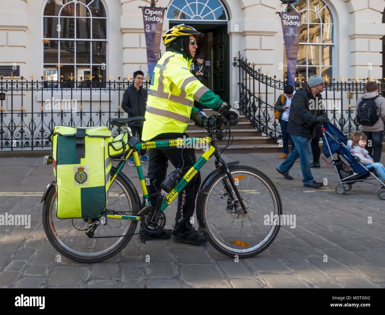 NHS National Health Service Emergency Response Paramedic providing support services by bicycle for in city centre - Stock Image