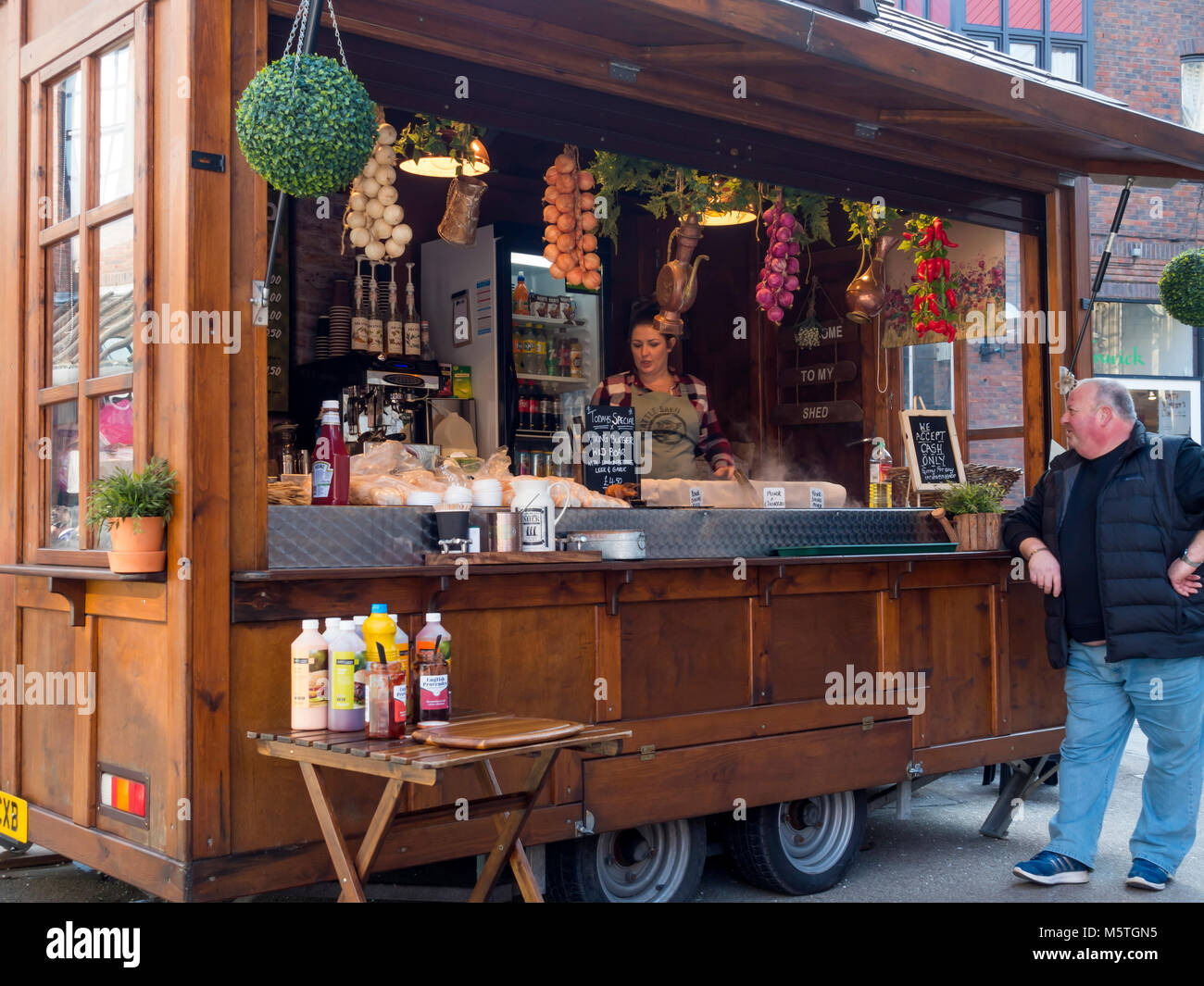 A man buying Viking themed fast food near the Jorvik Viking Centre in York City Centre England UK Stock Photo
