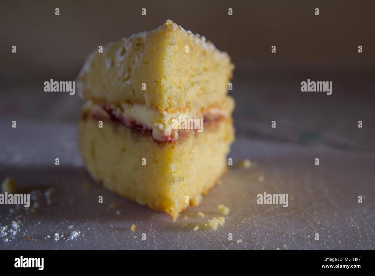 slice of Victoria sponge cake - Stock Image