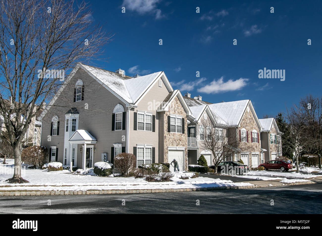 Suburban American townhouse after a recent snowfall. Stock Photo
