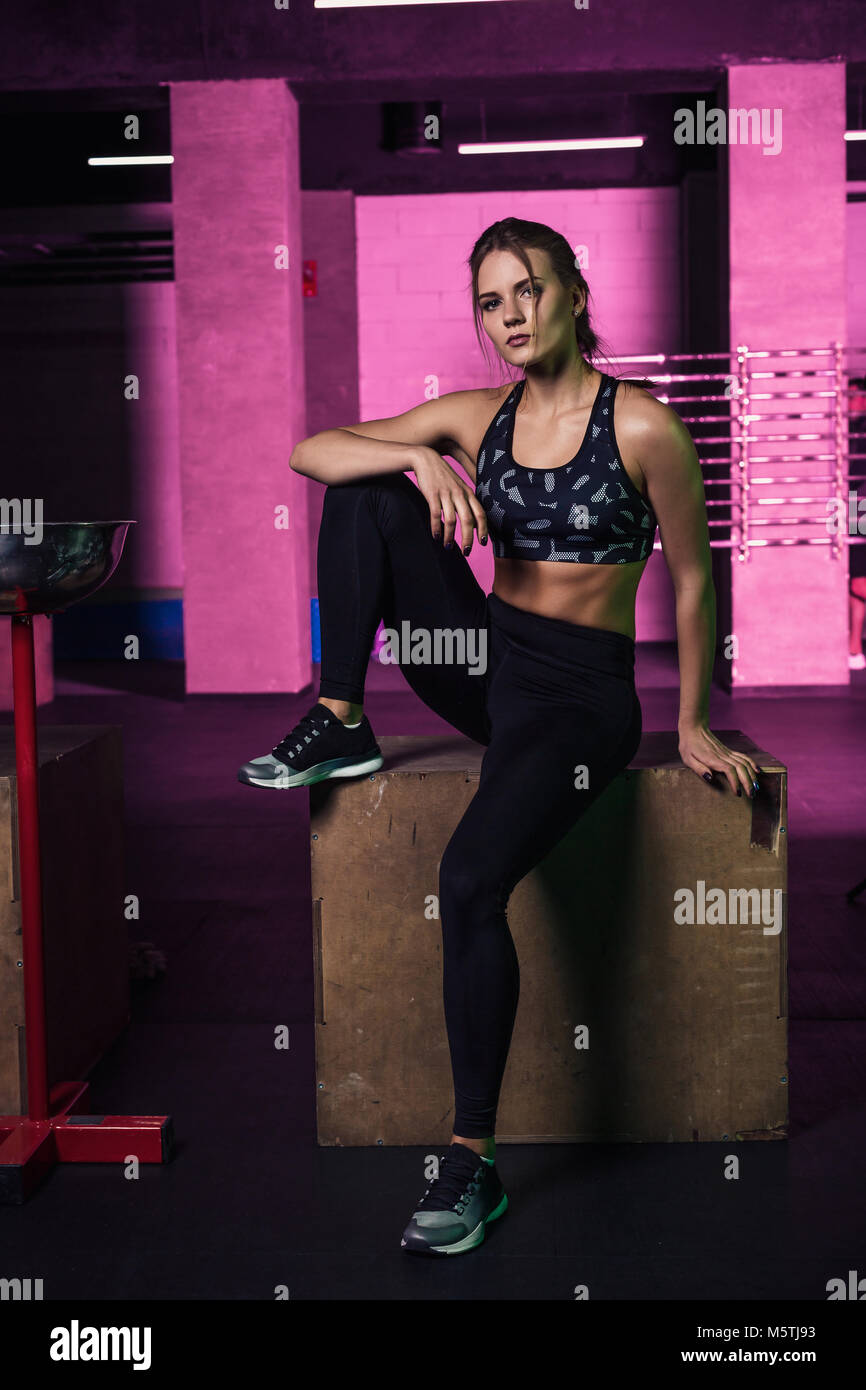 34d9d92ac Young beautiful woman posing in a gym outfit. Young healthy girl with a  perfect figure.