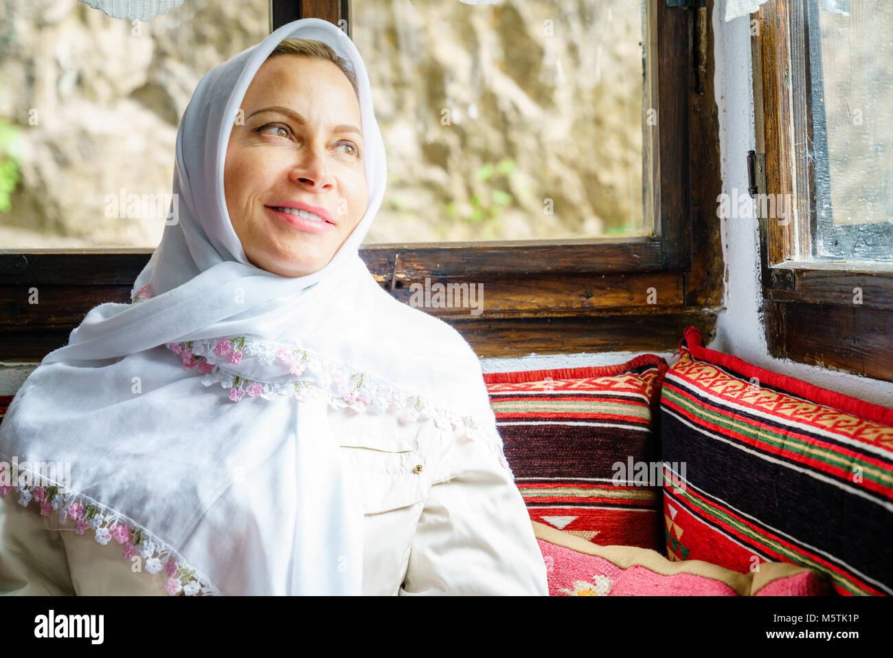 Portrait of a woman wearing traditional headscarf at a Dervish monastery in Bosnia - Stock Image