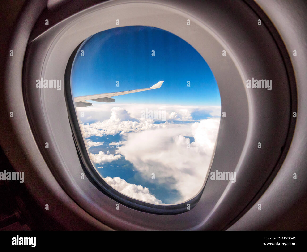 View through the porthole of aircraft. Stock Photo