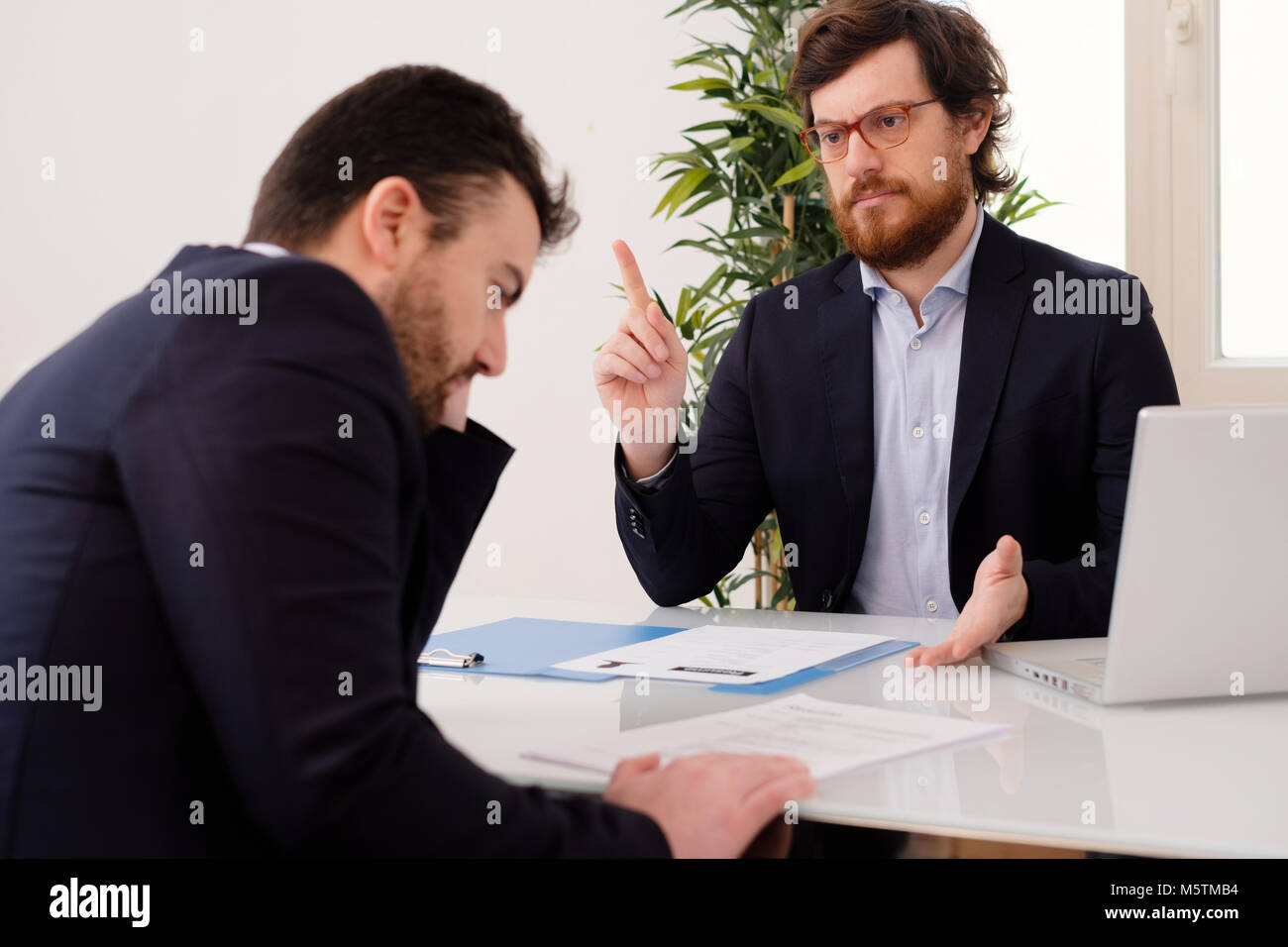 Anxious employee after a mistake during a boss conversation - Stock Image