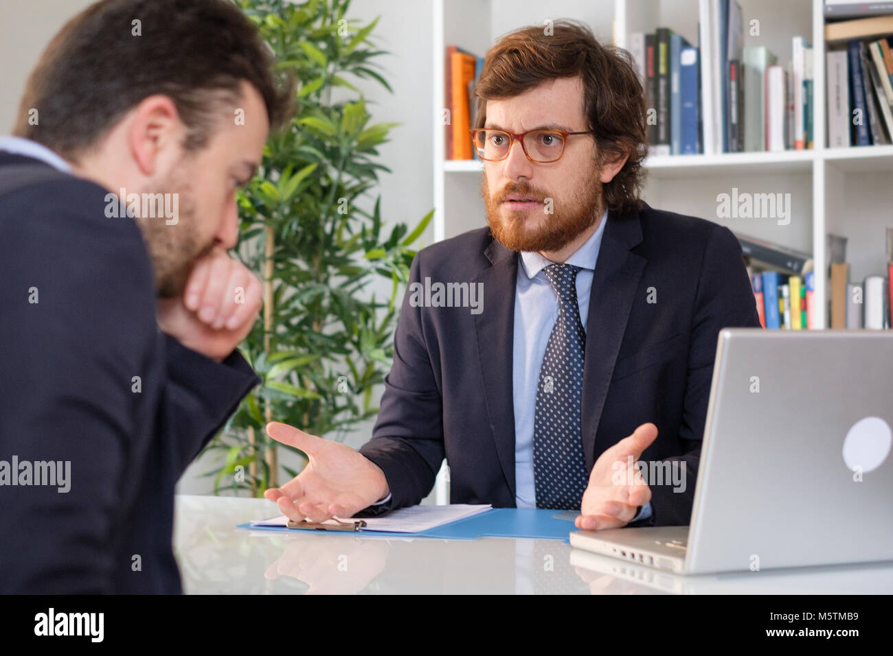 Businessmen arguing at workplace after deal failure and breaking contract - Stock Image