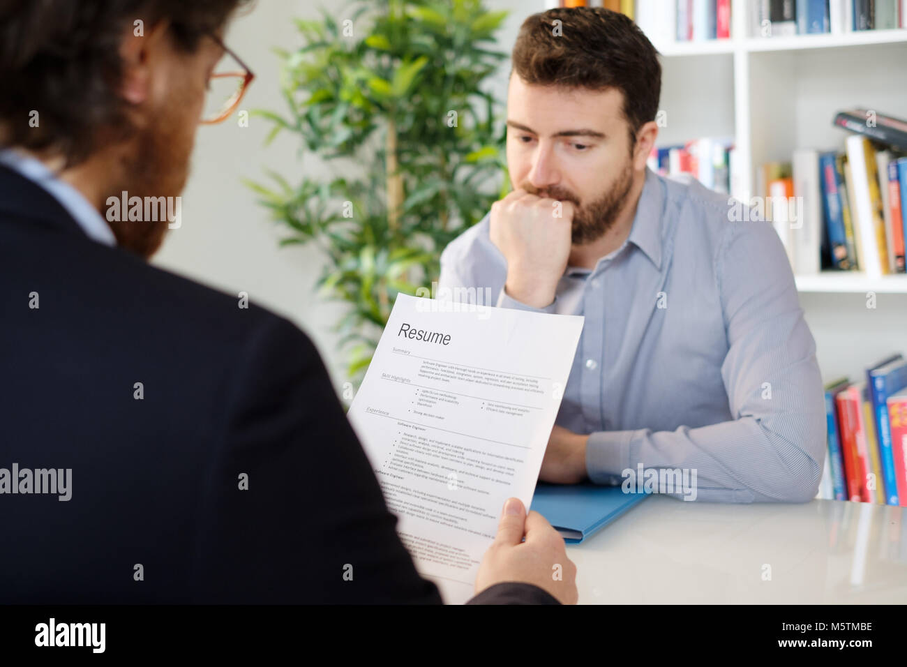 Nervous man during a job interview - Stock Image