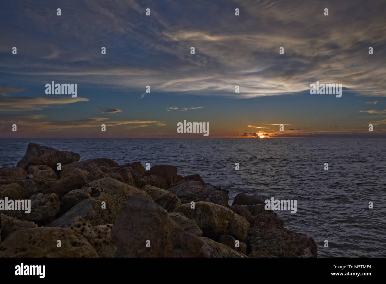 beautiful sunset at the calm sea - Stock Image