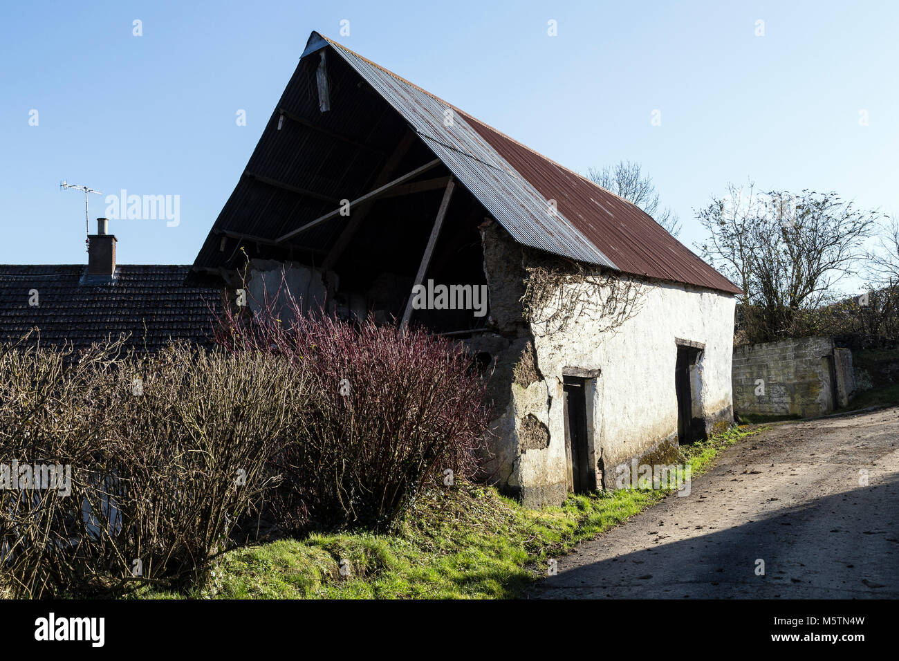 A large farm building used for storing grain, hay, or straw or for housing livestock.The triangular upper part of - Stock Image