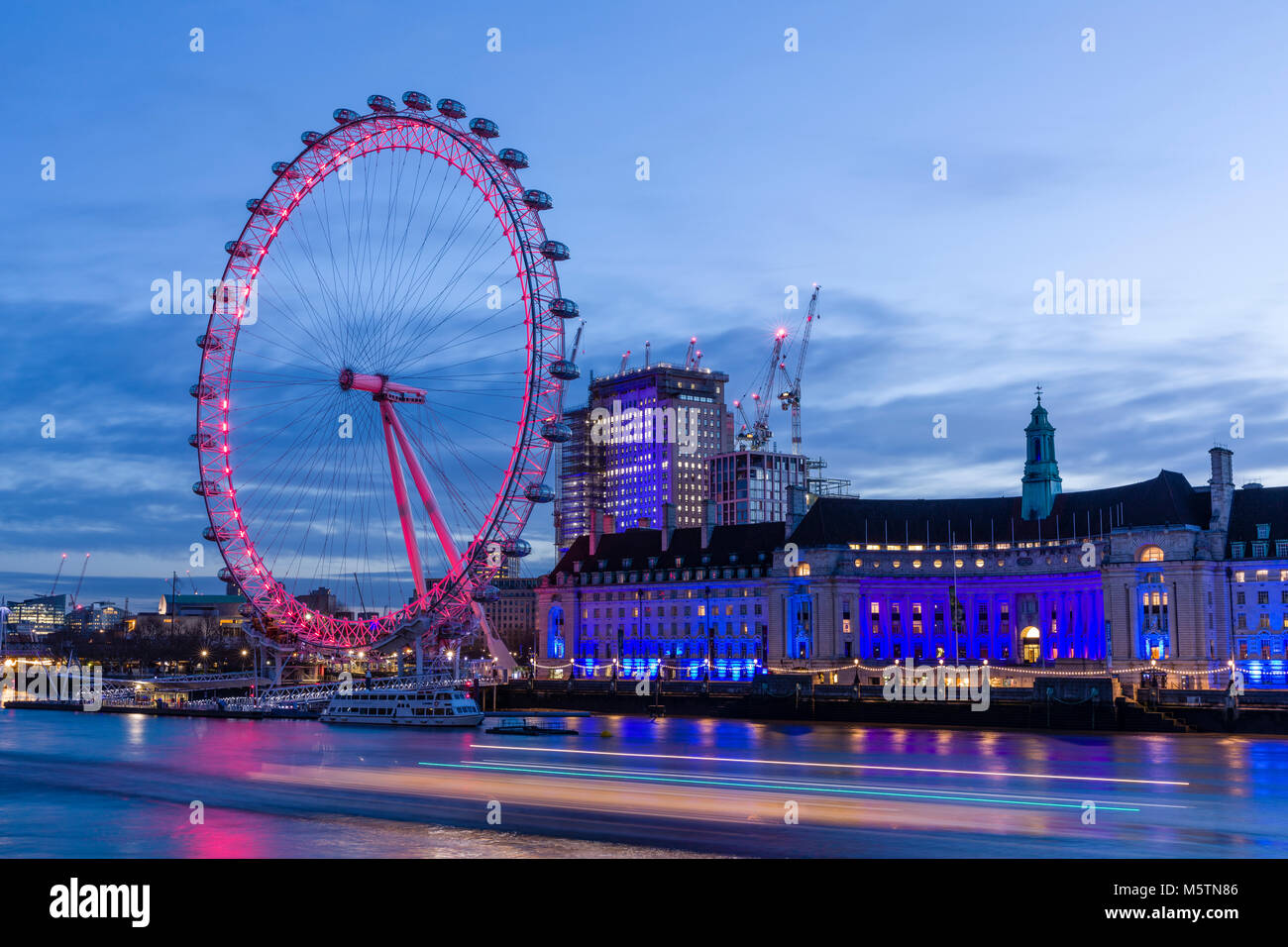 The London Eye and County Hall at dawn Stock Photo