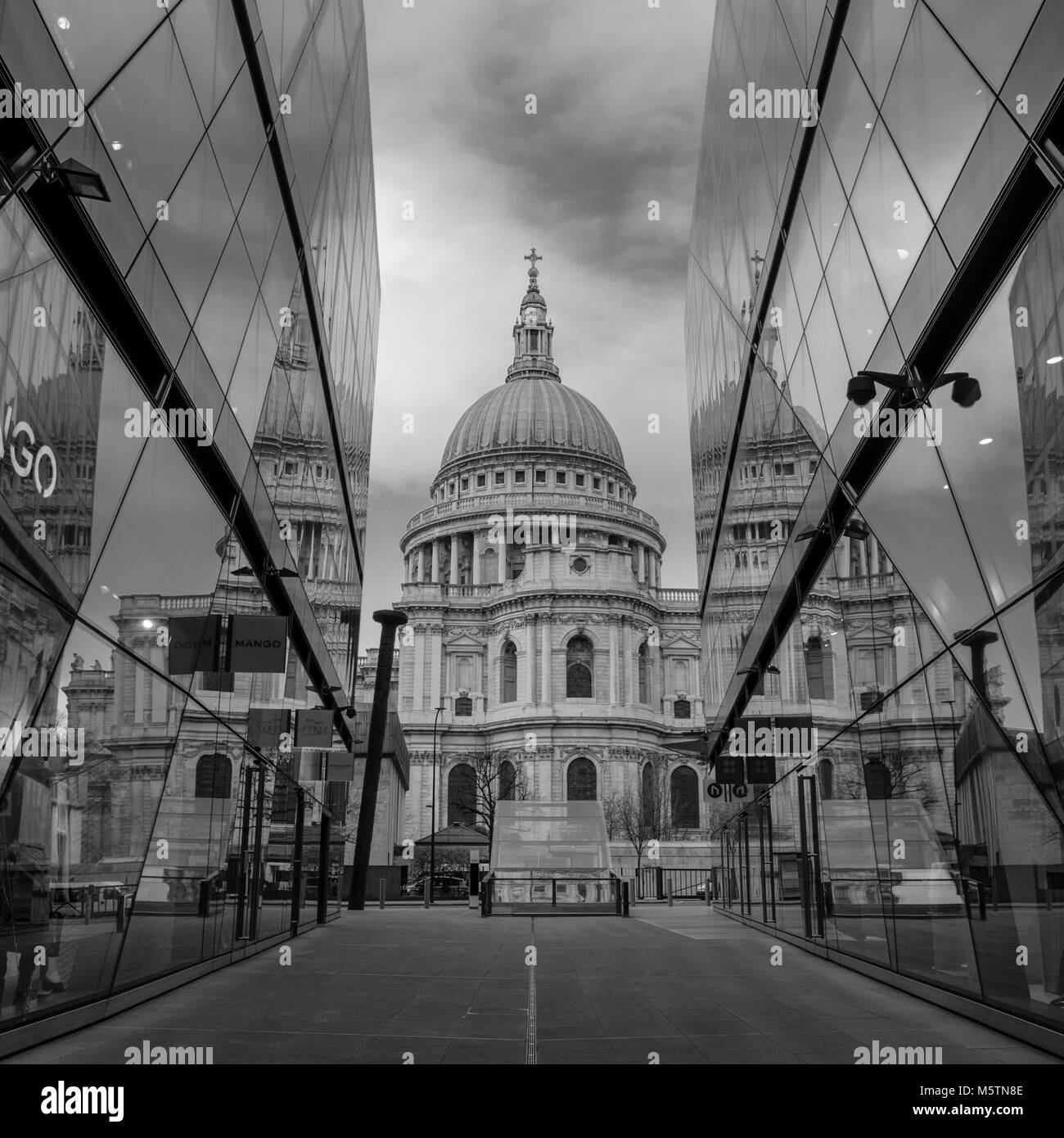 St Paul's Cathedral reflections in the glass windows of One New Change shopping centre - Black and White - Stock Image