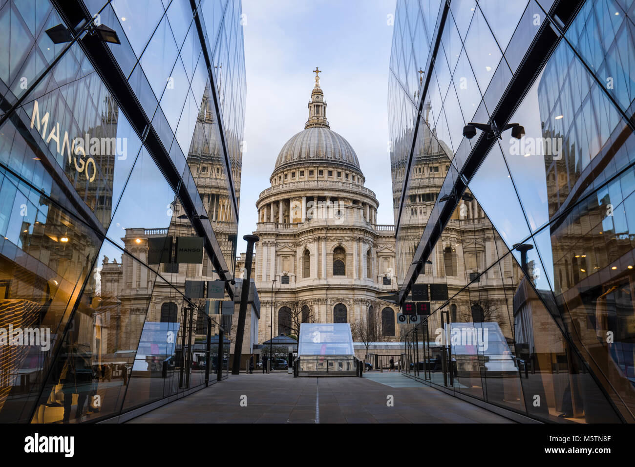 St Paul's Cathedral reflections in the glass windows of One New Change shopping centre - Stock Image