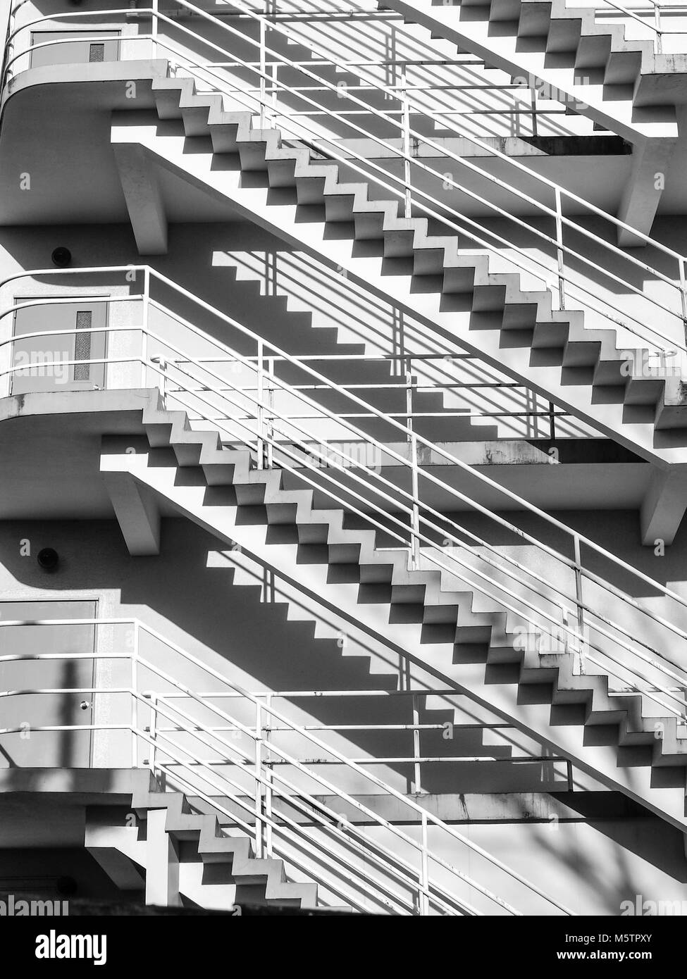 Abstract of floors outdoor stairways in black and white. - Stock Image