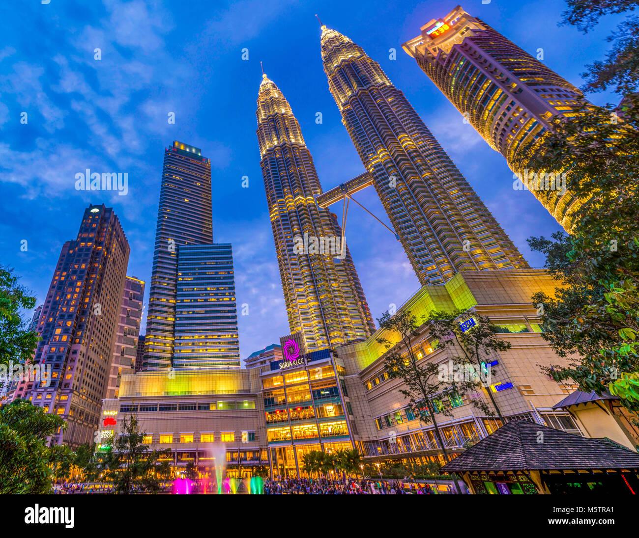 Kuala Lumpur neon night Petronas Towers KLCC Park illuminated Malaysia - Stock Image