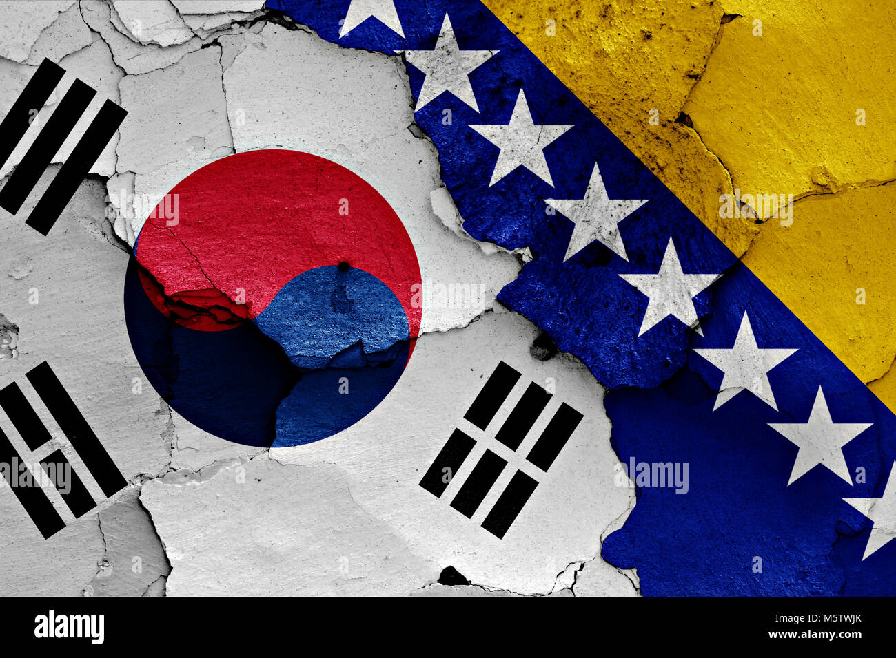 flag of South Korea and Bosnia and Herzegovina painted on cracked wall - Stock Image