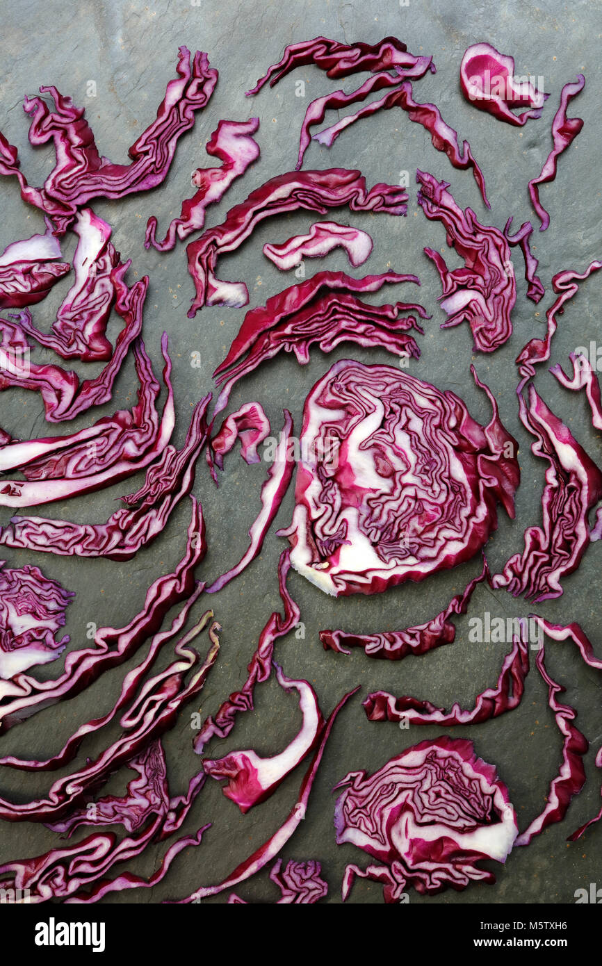 Arrangement of colorful red cabbage on slate table - Stock Image
