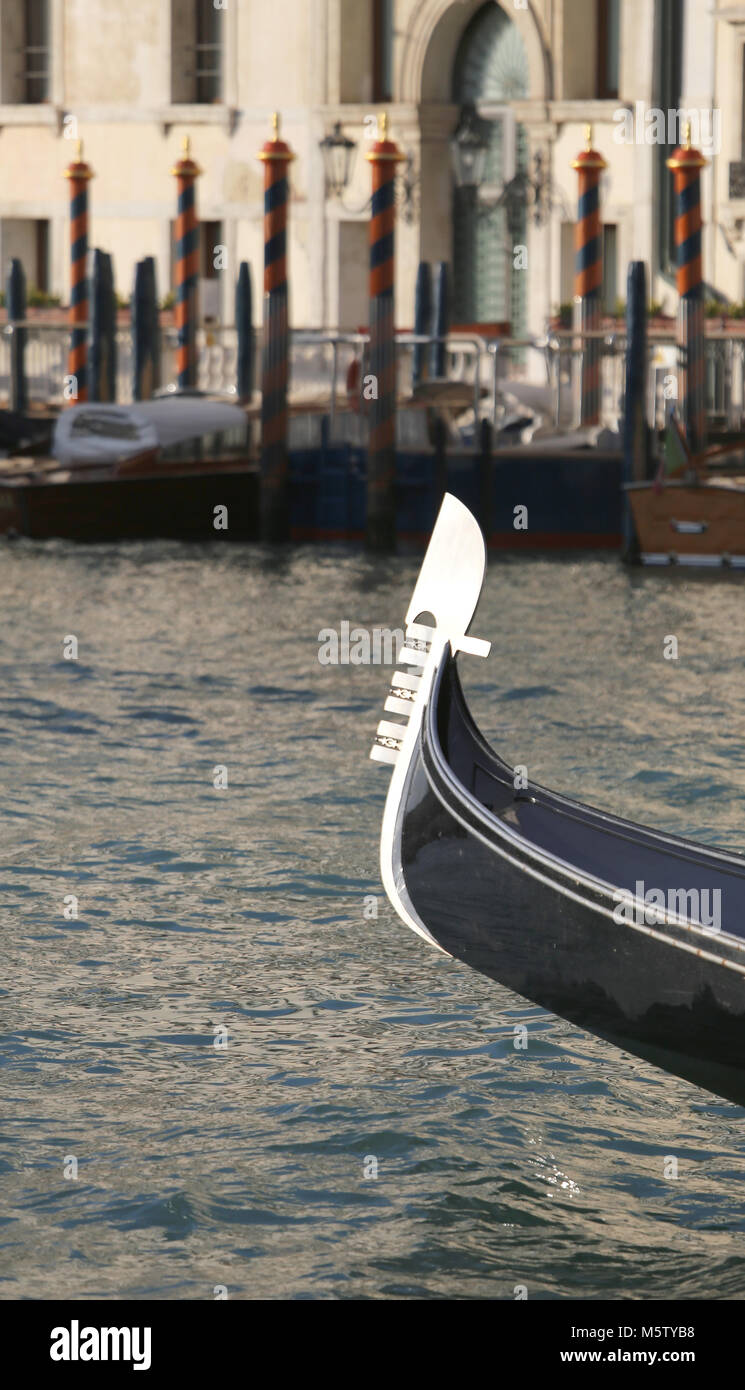 Typical boat called GONDOLA in Venice in Northern Italy saling in Grand Canal - Stock Image