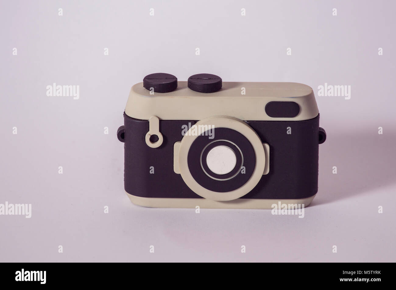 portable mobile phone charger in the shape of a camera on a white background - Stock Image