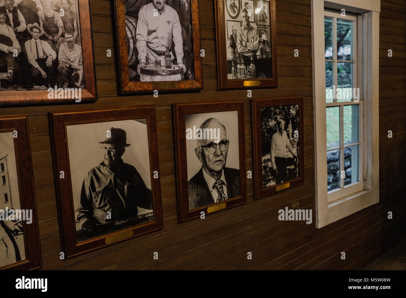 Historic photos in frames on a wall at the Jack Daniels Distillery, Lynchburg, Tennessee, North America - Stock Image