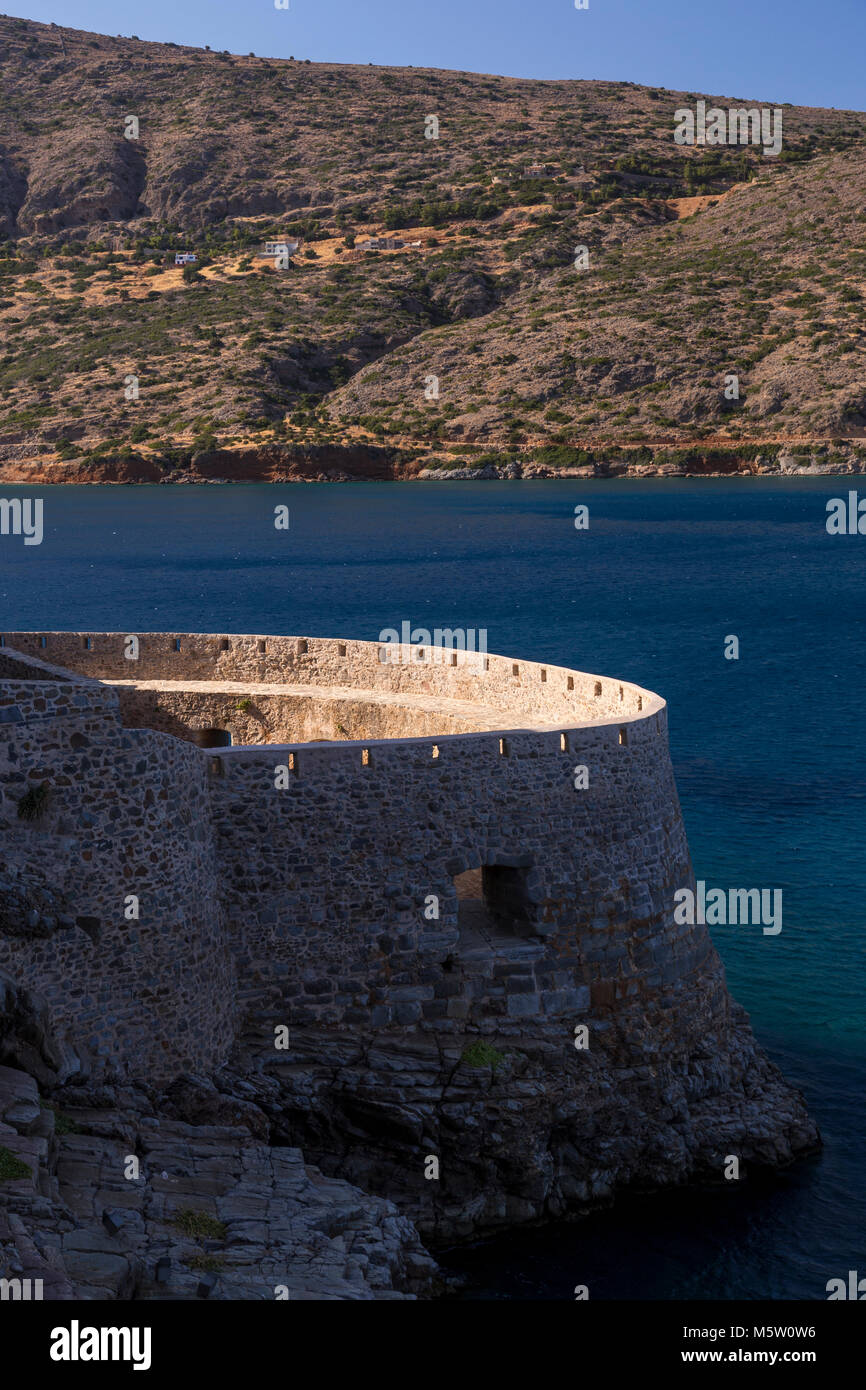 Fortifications on the island of Spinalonga, Crete with the Mediterranean sea - Stock Image