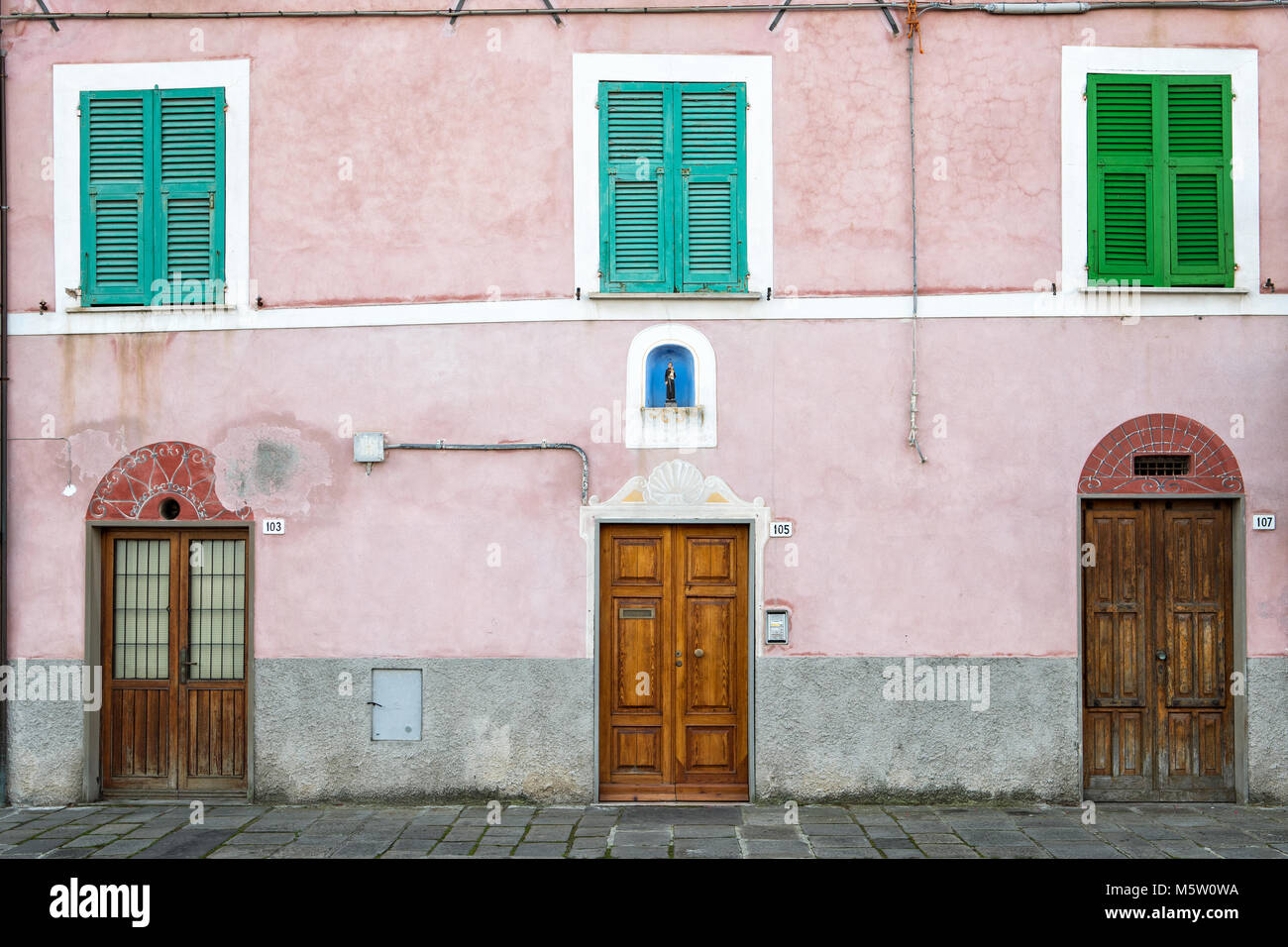 Closed doors and shutters of a building in Le Grazie, Porto Venere, Liguria, Italy - Stock Image