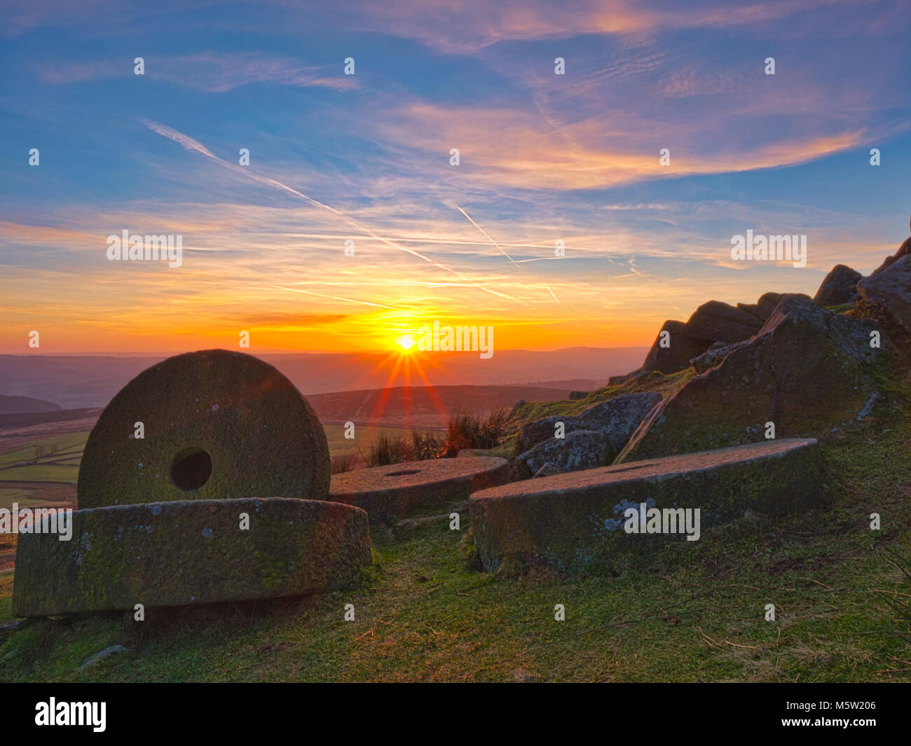 spectacular sunset over the millstones at Stanage Edge near Hathersage, Peak District National Park, Derbyshire - Stock Image