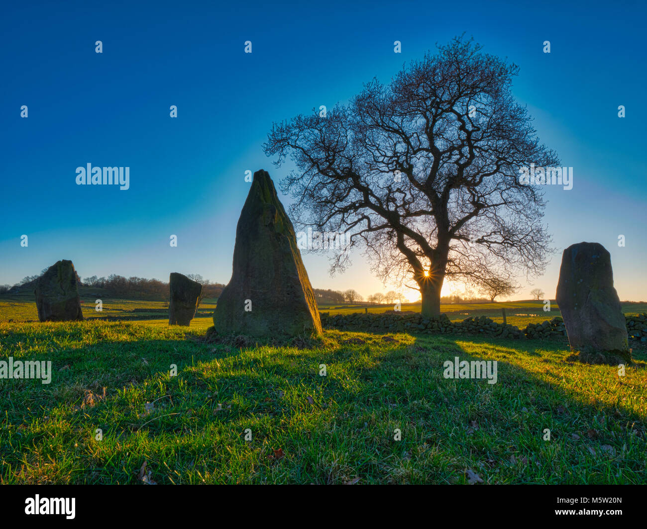 spectacular sunset on a bitterly cold day at The Grey Ladies / Nine Stone Close Stone Circle, Robin Hood's Stride Stock Photo