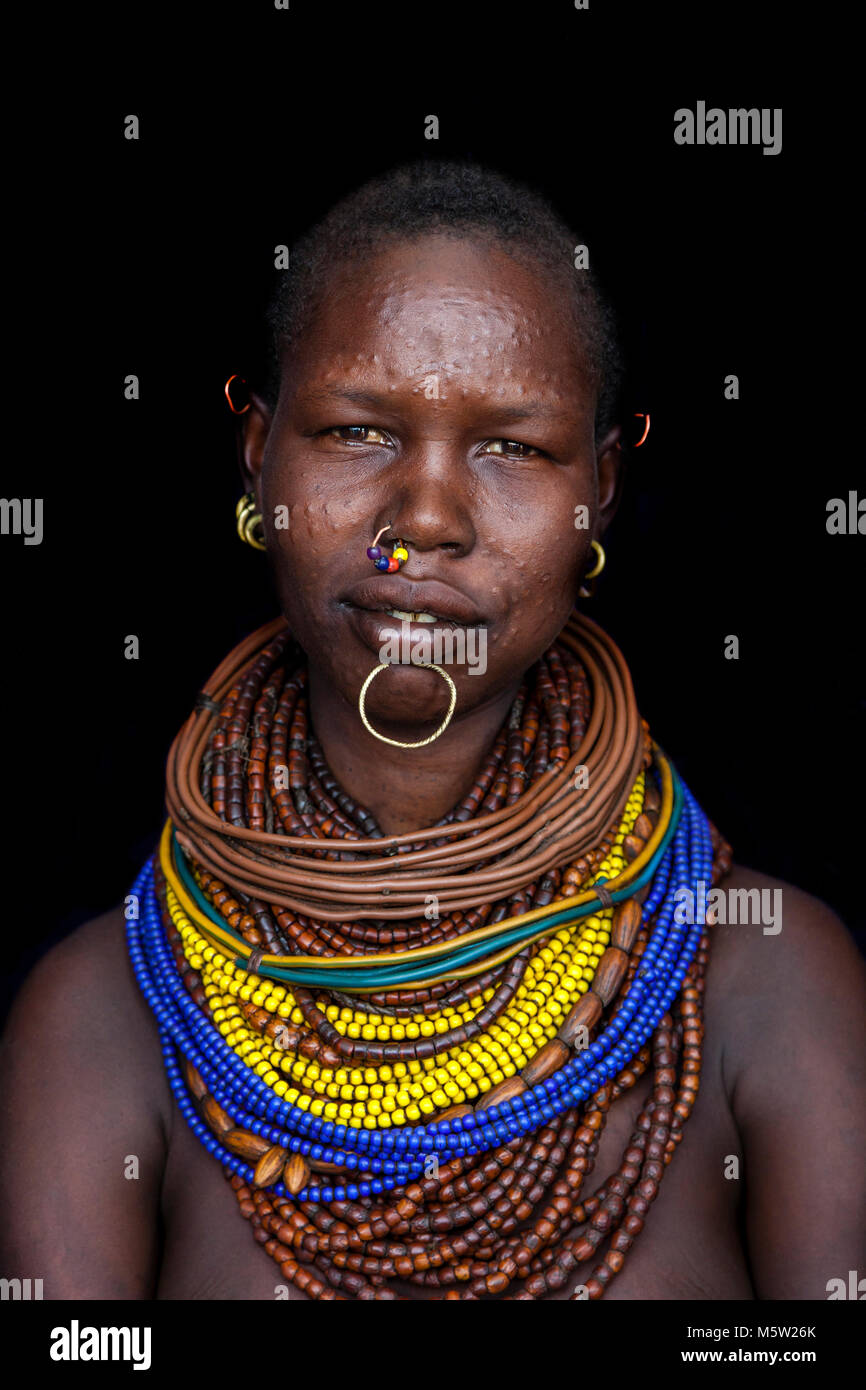 A Portrait Of A Young Woman From The Nyangatom Tribe, Lower Omo Valley, Ethiopia Stock Photo