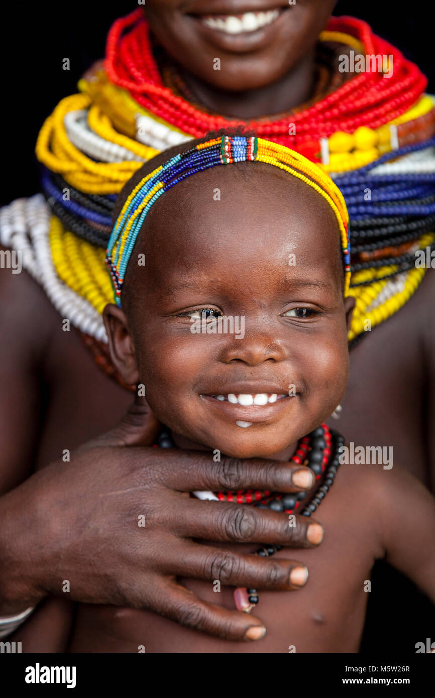 A Portrait Of A Young Mother and Baby From The Nyangatom Tribe, Lower Omo Valley, Ethiopia Stock Photo