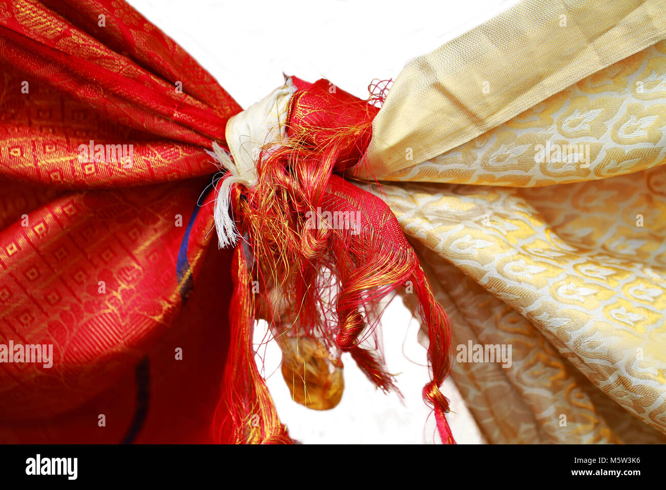 The Wedding Knot.Hindu Wedding Knot Tied With Man And Woman Dress White Background