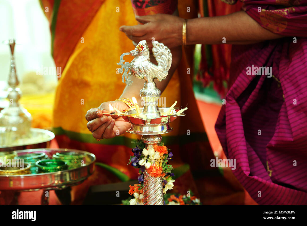 Hindu wedding rituals Traditional south Indian brass oil lamp - Stock Image