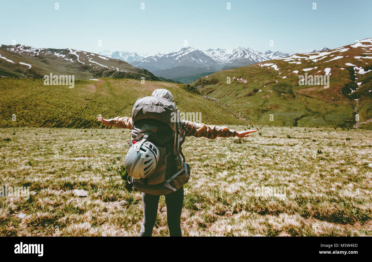 Happy woman with backpack raised hands on hike in mountains Travel healthy lifestyle adventure concept active summer - Stock Image