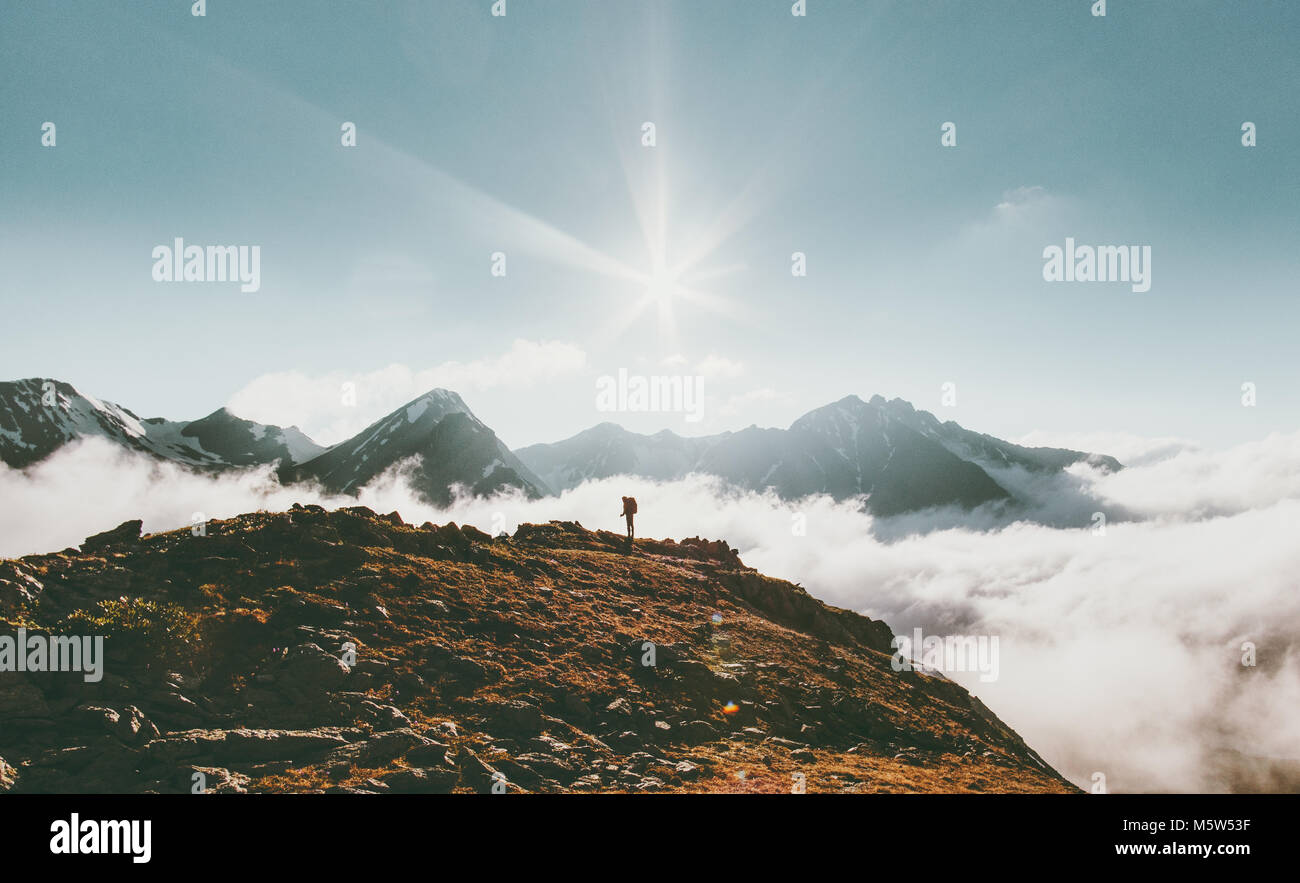 Traveler in mountains clouds landscape Travel lifestyle adventure concept summer vacations outdoor scale showing - Stock Image