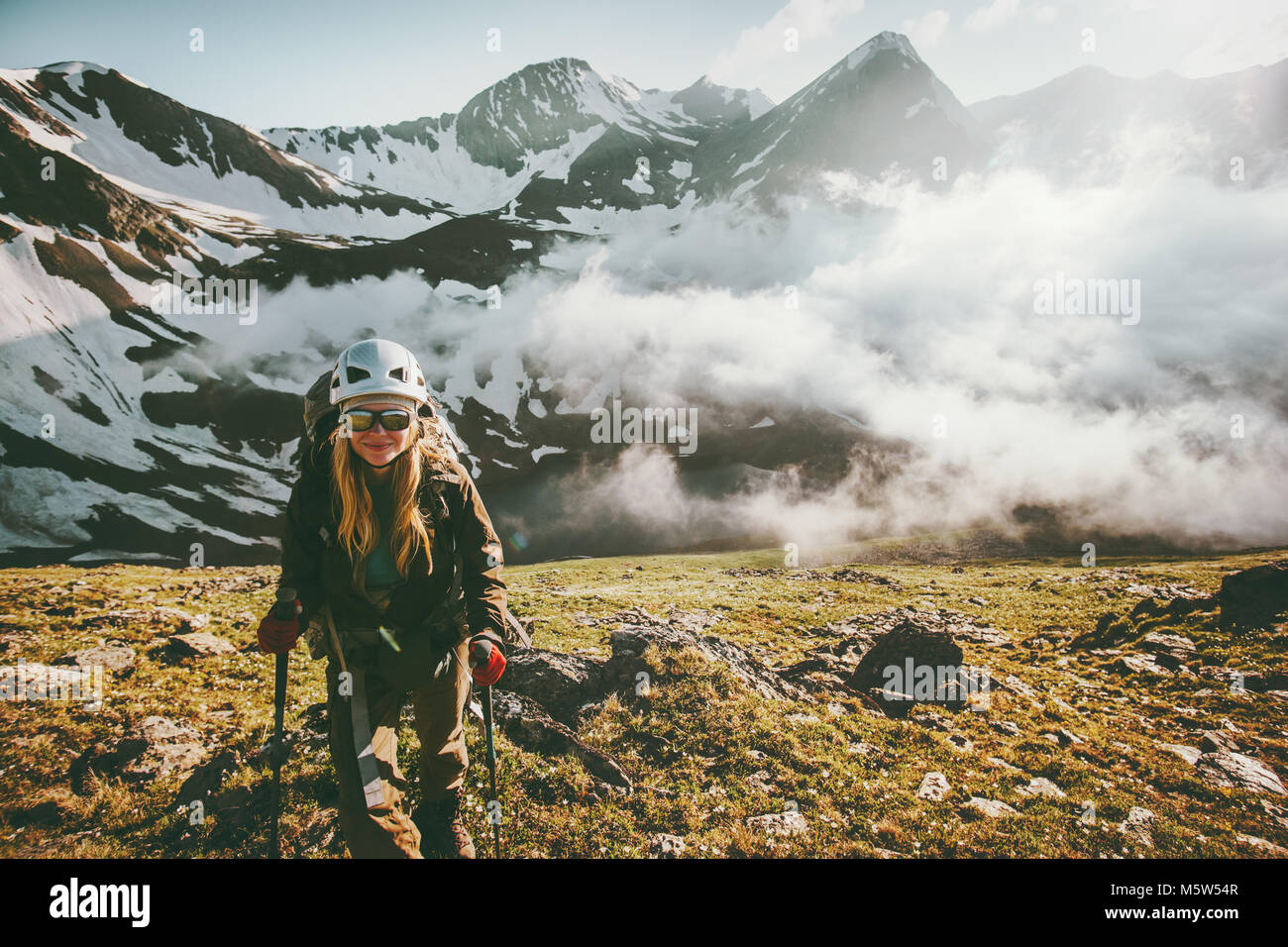 Woman traveler hiking mountains sunset  landscape Travel lifestyle adventure concept active summer vacations outdoor - Stock Image