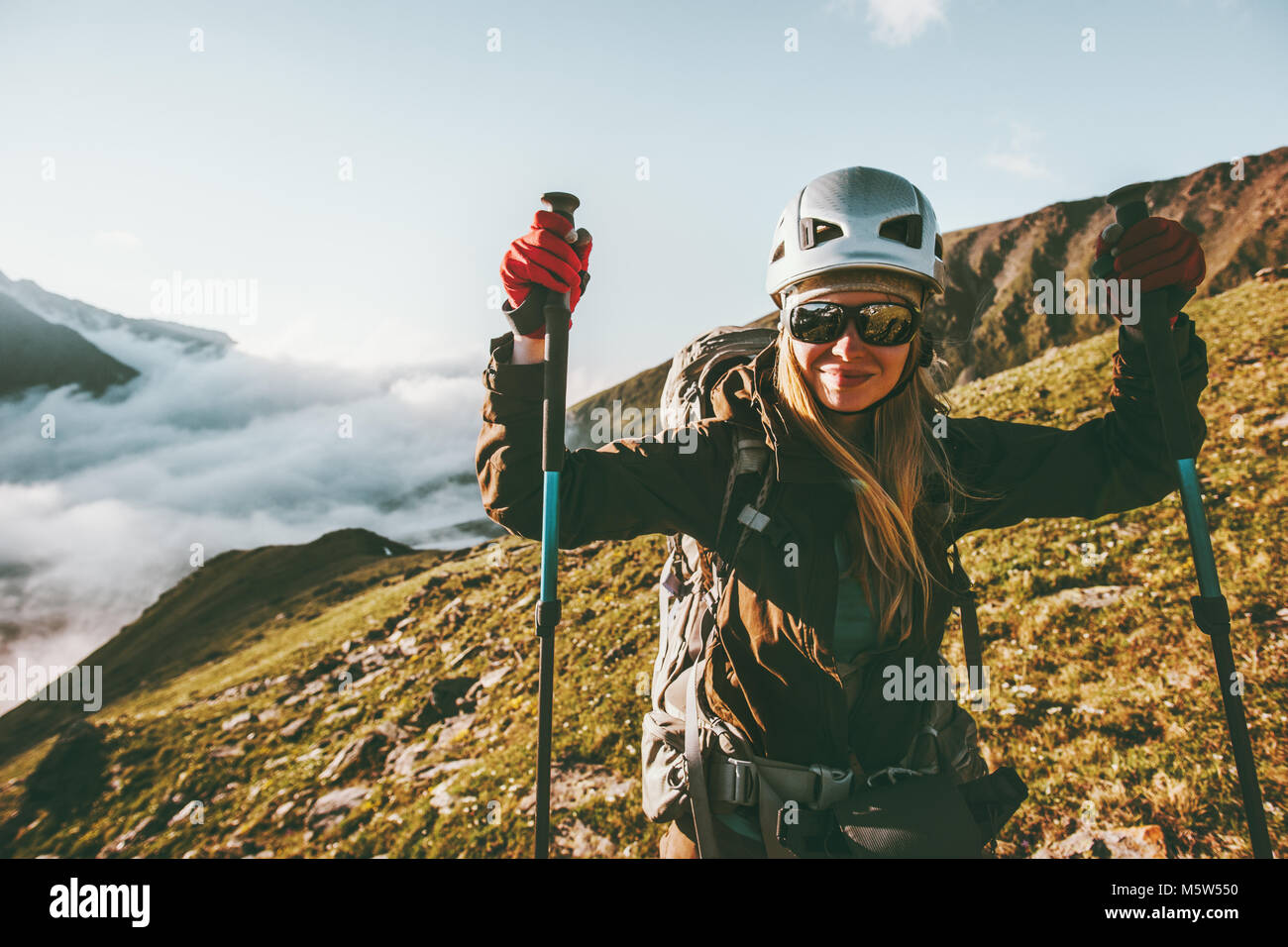 Woman hiking in mountains Travel healthy lifestyle adventure concept active summer vacations outdoor positive emotions - Stock Image