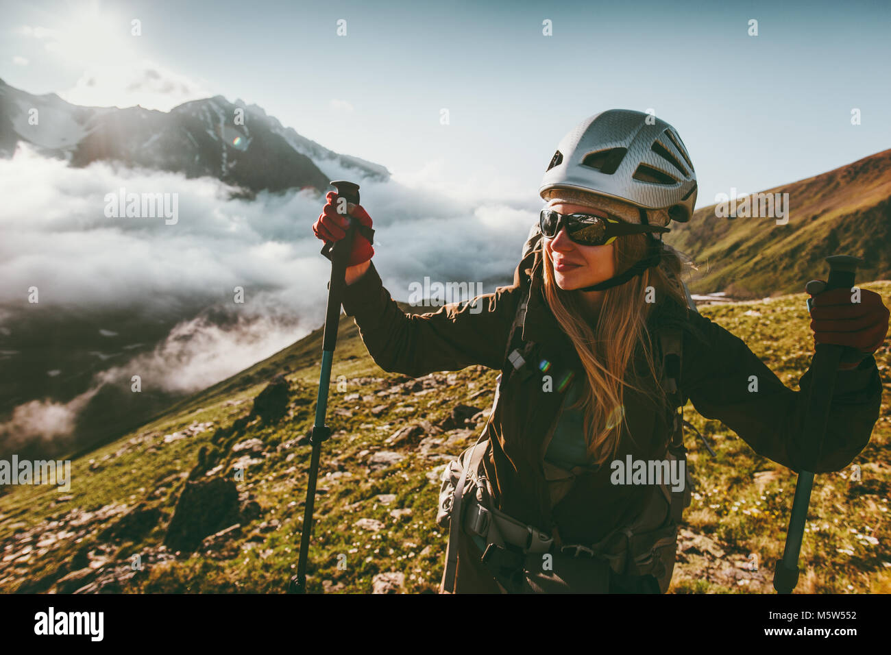 Happy woman enjoying sunset mountains landscape Travel healthy lifestyle adventure concept active summer vacations - Stock Image