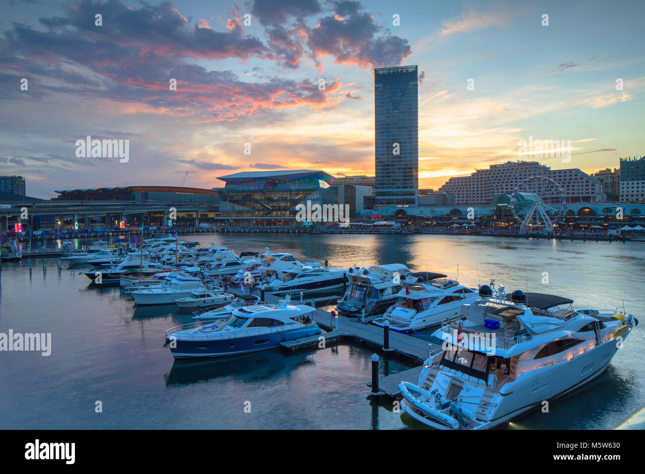 Sofitel Hotel and International Convention Centre at sunset, Darling Harbour, Sydney, New South Wales, Australia - Stock Image