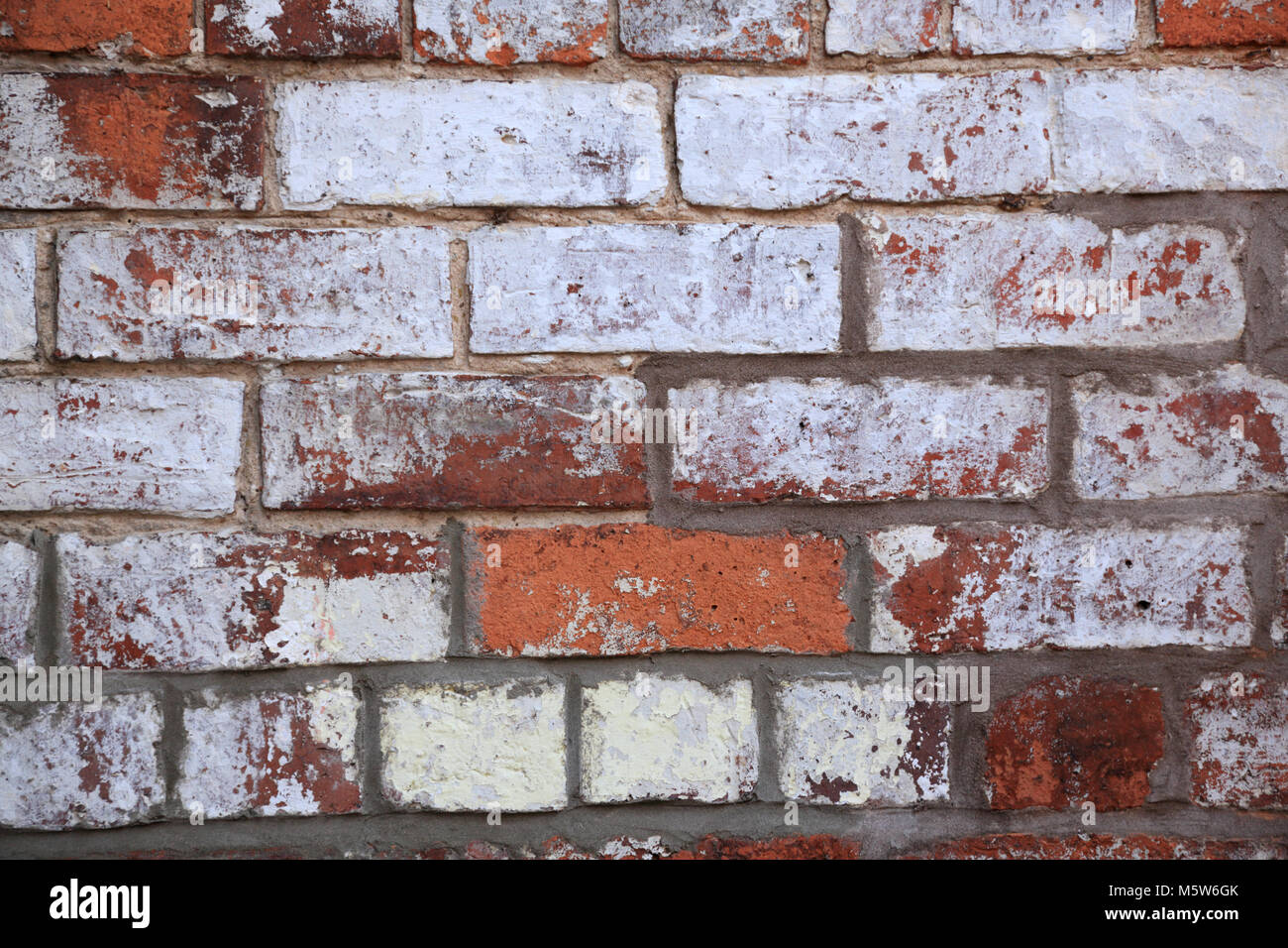 Old neglected brick wall. - Stock Image