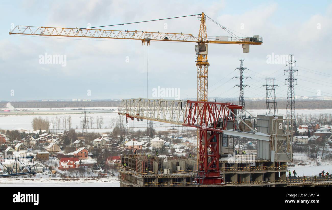 High Tower cranes above a skyscraper winter skyline - Stock Image