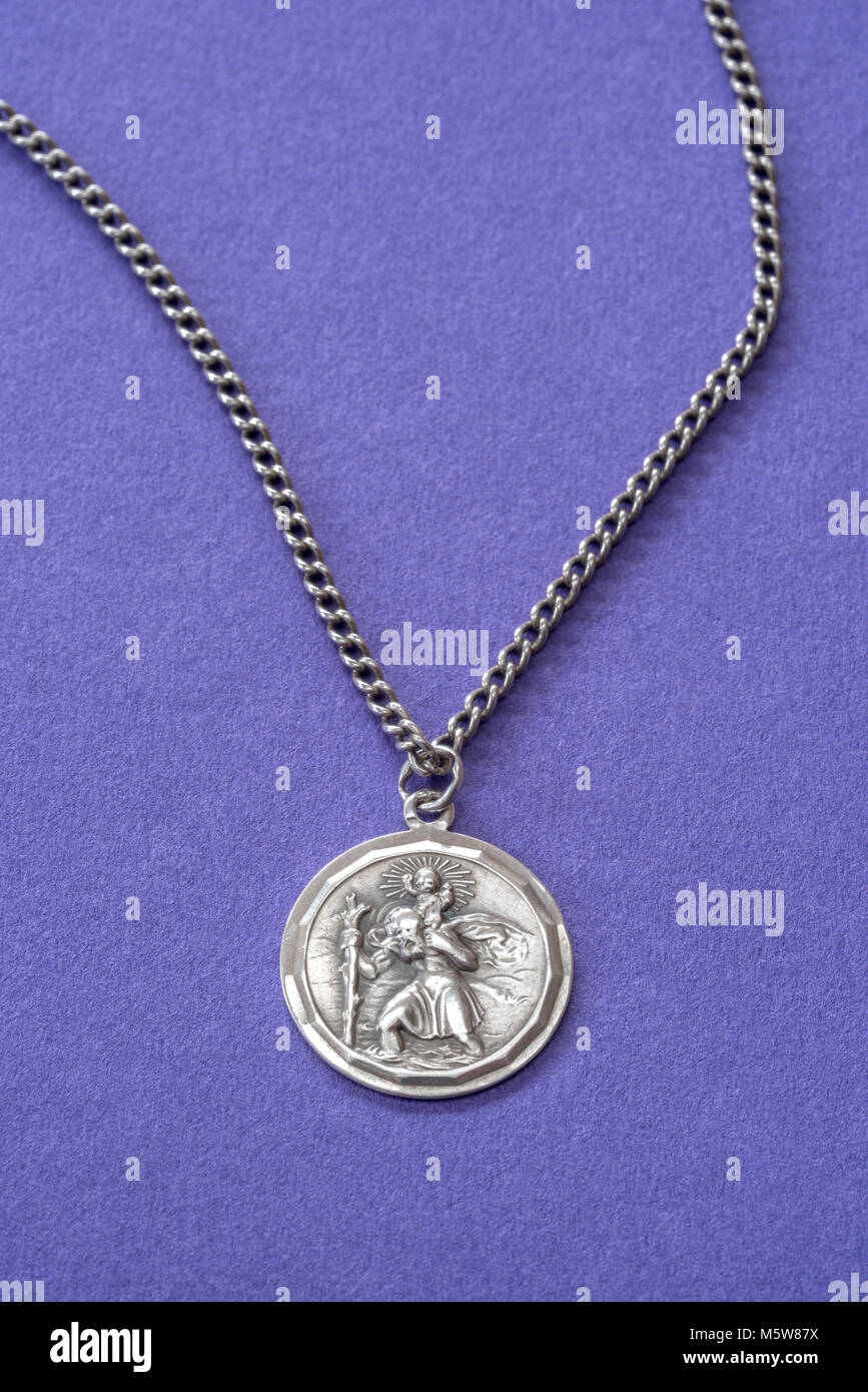 Silver St Christopher medallion and chain. - Stock Image