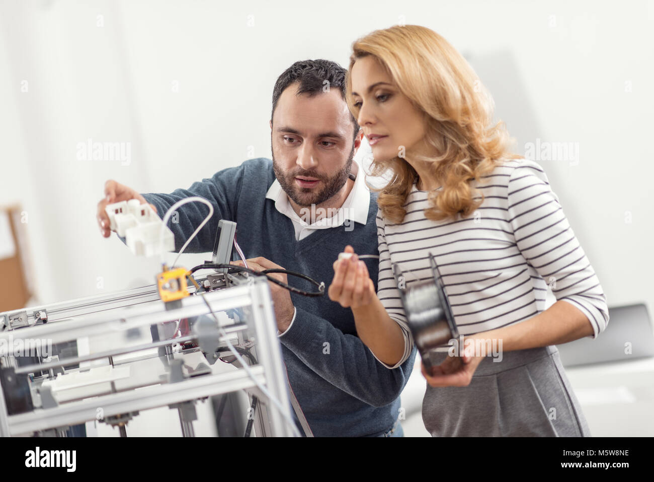 Pleasant colleagues running out of a filament - Stock Image