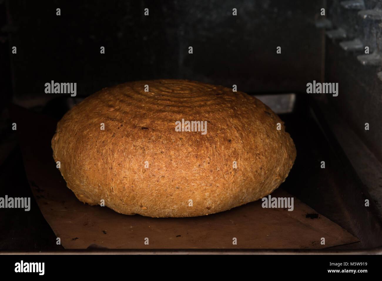 homemade handmade bread baking in oven - Stock Image