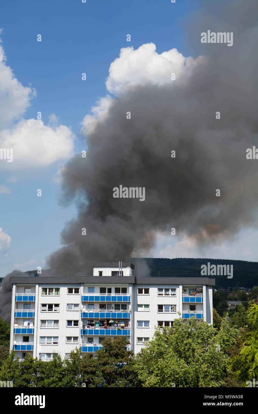 Fire behind a residential building, Meinerzhagen, North Rhine-Westphalia, Germany, Europe - Stock Image