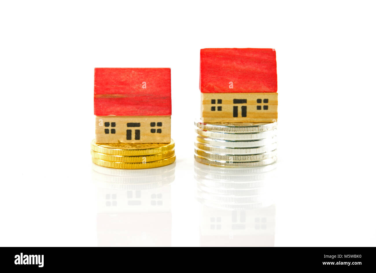 houses on  the market for sale with bitocins or other gold and silver coins - Stock Image
