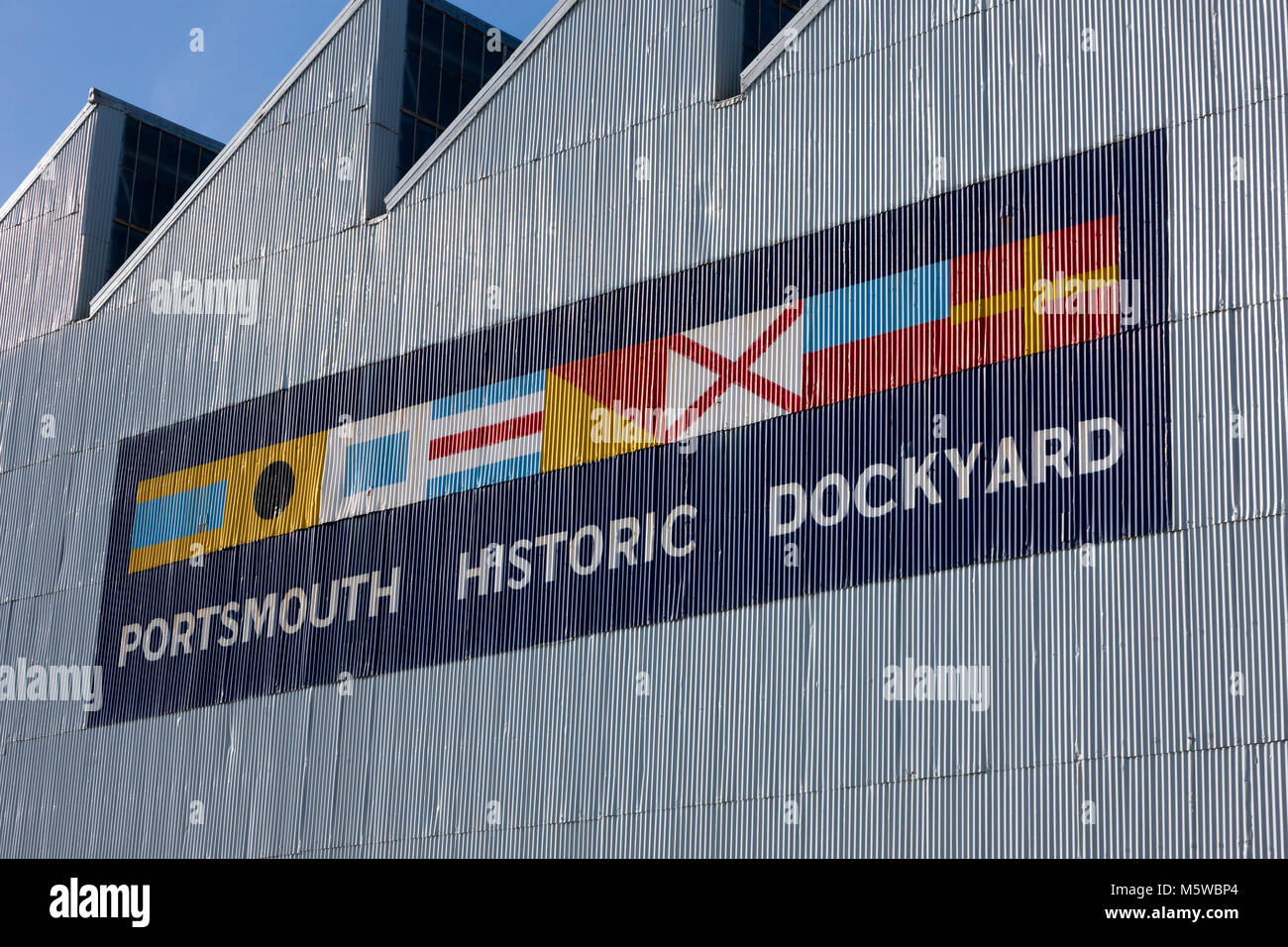 Boathouse number 4 / Boat House Four at Portsmouth historic dockyard, painted with the dockyard logo on it. Portsmouths - Stock Image