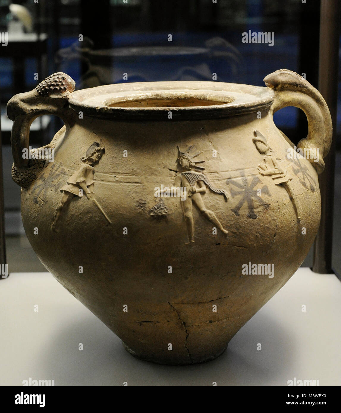 Pottery depicting Mithras surrounded by the torch-bearers Cautes and Cautopates. 2nd-3rd centuries. From Cologne, - Stock Image