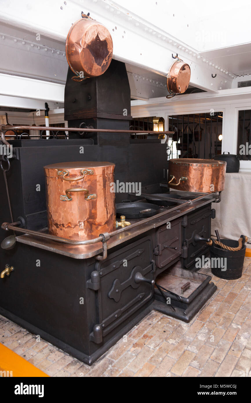 Galley stove ( cooker / oven / range / hob) for cooking hot food for the ship's crew ) on the Gun Deck of HMS - Stock Image