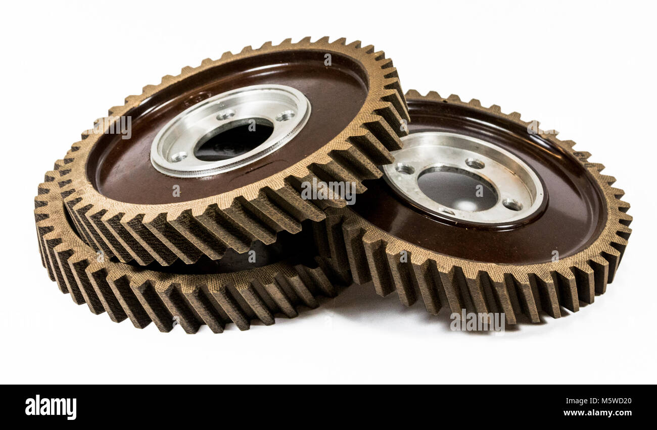 Antique automotive fiber camshaft timing gears stacked - Stock Image