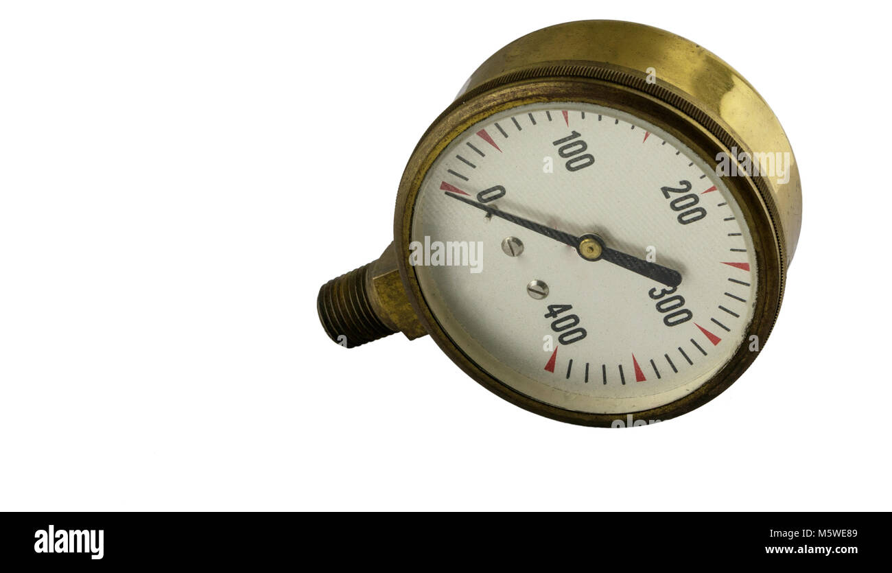 Antique vintage brass pressure gauge with threaded pipe fitting on a white background - Stock Image